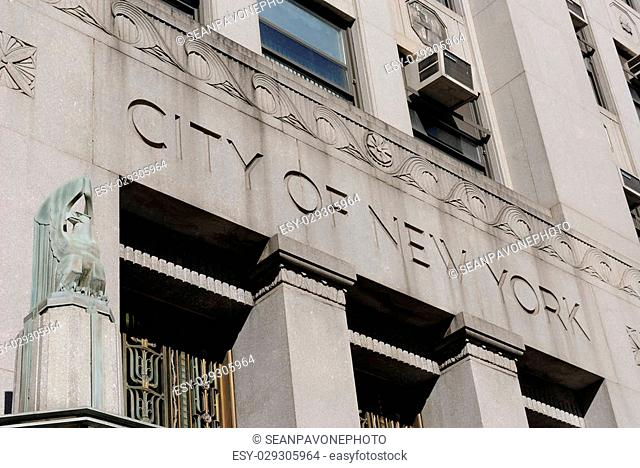 City of New York carved on a government building's facade