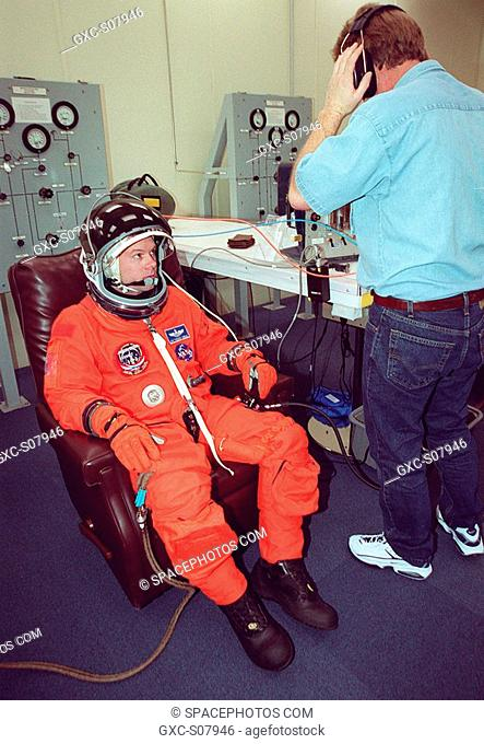 03/08/2001 --- STS-102 Pilot James Kelly gets a final fitting in his launch and entry suit. This will be Kelly's first Shuttle launch