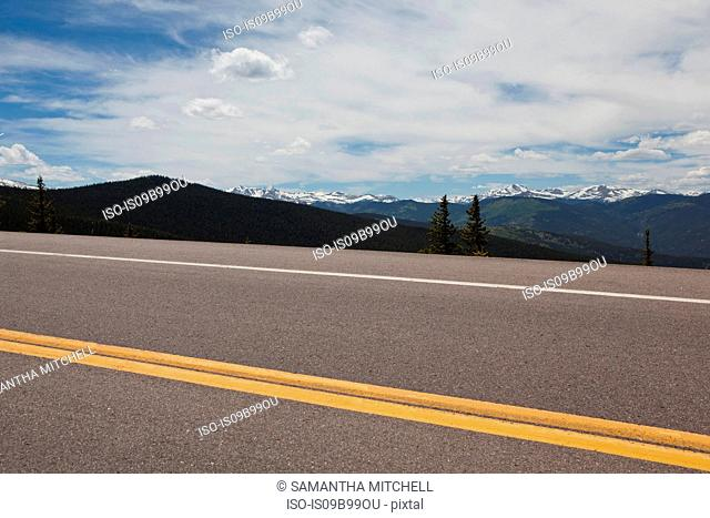 Squaw Pass highway and distant mountains, Evergreen, Colorado, USA