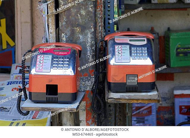 Two coin payphones in a shop in Santacruz district, Mumbai, Maharashtra, India