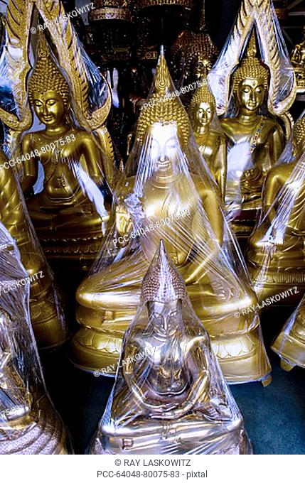 Thailand, Bangkok, Phahurat, Th Phra Phtak, Buddha wrapped in plastic for distribution