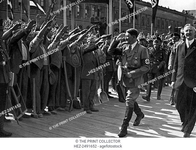 Laying of the foundation stone of the Reichsbank, Berlin, Germany, 5 May 1934. German Nazi leader Adolf Hitler (1889-1945) with Reichsbank President Hjalmar...