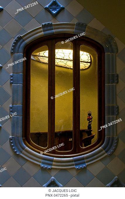 Spain, Catalonia, Barcelona, window on the inner courtyard of the Casa Batllo, architect: Antoni Gaudi