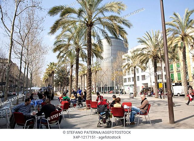 Street Cafe and Barcelo Hotel on the Rambla del Raval in Barcelona, Spain