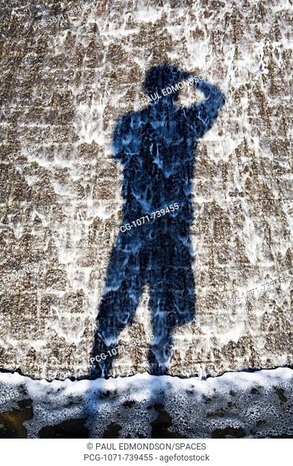 Shadow of Photographer Taking Picture