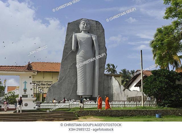 monumental statue of Buddha at Uthpalawanna Sri Vishnu Devalaya Temple, both Buddhist and Hinduist place of worship, Dondra, South Coast, Sri Lanka