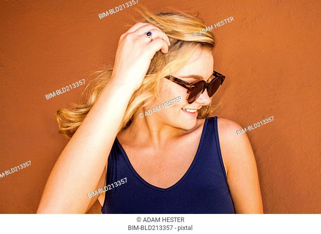 Caucasian teenage girl wearing sunglasses
