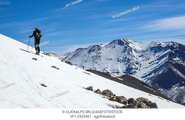 Skier climbing in Lefka Ori, Crete, Greece, Mediterranean sea