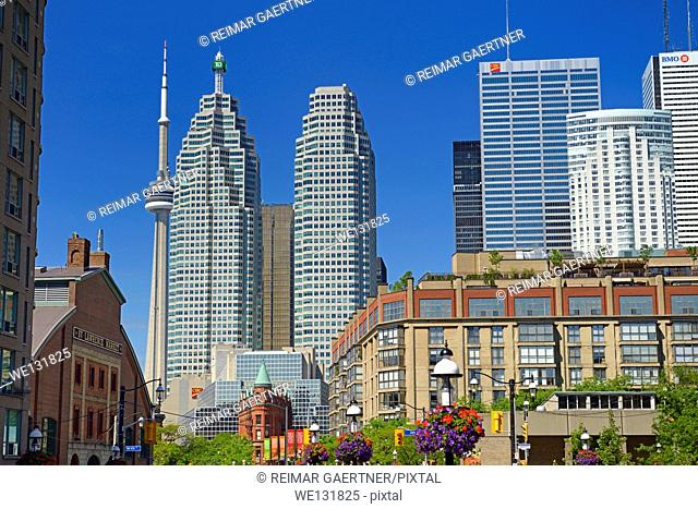 St Lawrence Market and Gooderham Flatiron building with financial district bank towers and CN tower Toronto
