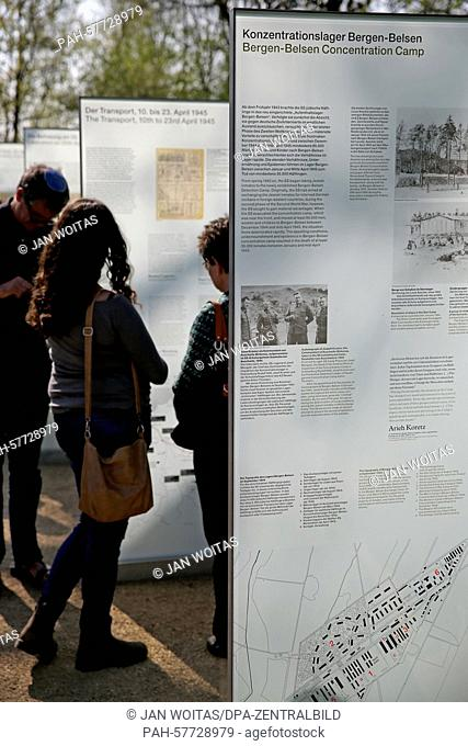Visitors look at steles of an exhibition on the victims of the 'Lost Train', headed from Bergen Belsen concentration camp to Troebitz