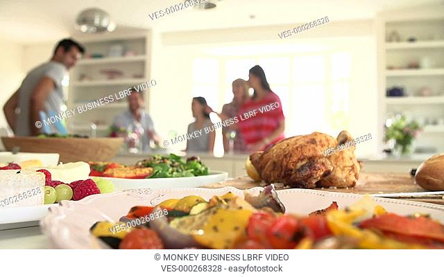 Group of friends meeting in kitchen for party - eating,talking and drinking.Shot on Sony FS700 in PAL format at a frame rate of 25fps