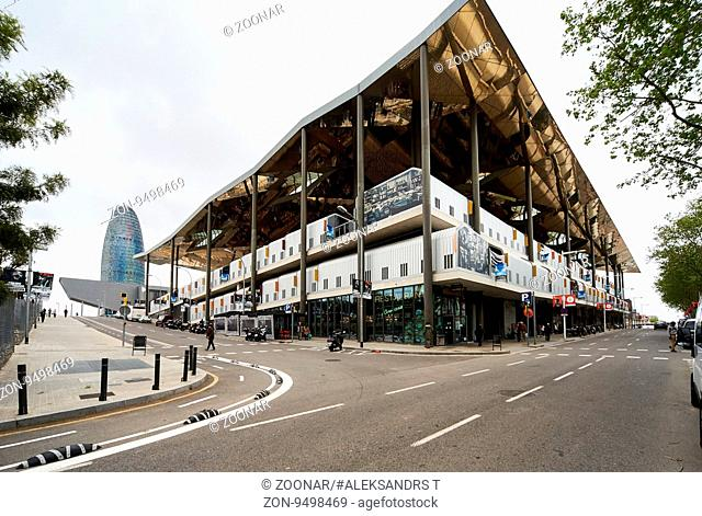 Barcelona, Spain - April 4, 2016: View to the Tower Agbar skyscraper and Mercat dels Encants. Mercat dels Encants is a Barcelona's largest and best known flea...