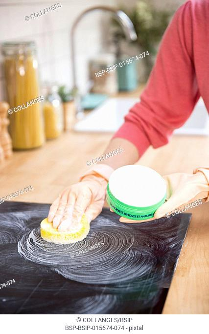 Woman using a clay bar