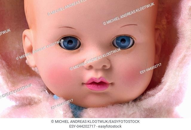 Very old baby doll (1940s), made with authentic clothing, isolated