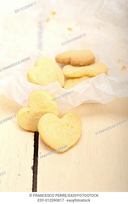 fresh baked heart shaped shortbread valentine day cookies on a paper wrap