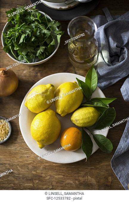 Lemon, orange, and fresh herbs