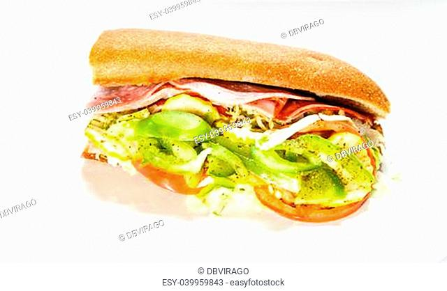 A fresh italian sub sandwich garnished with tomatoes, peppers and lettuce