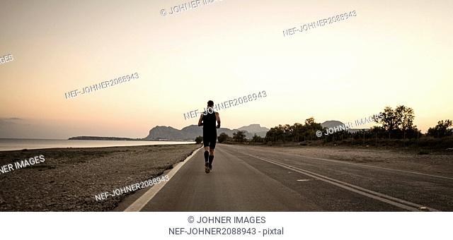 man running at sea