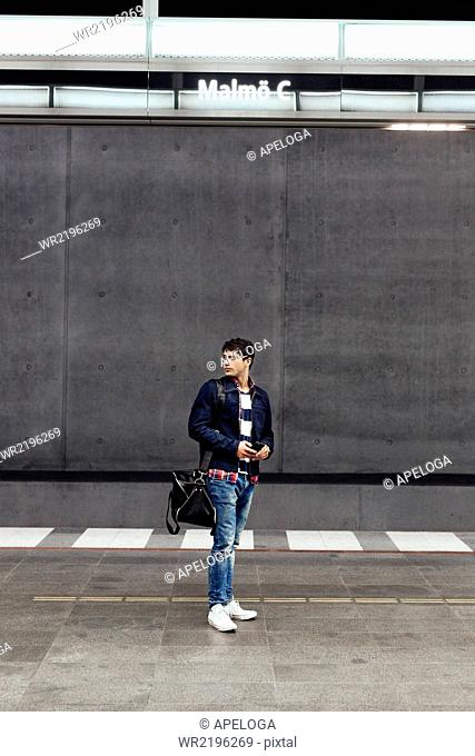 Full length of man standing on railroad station platform