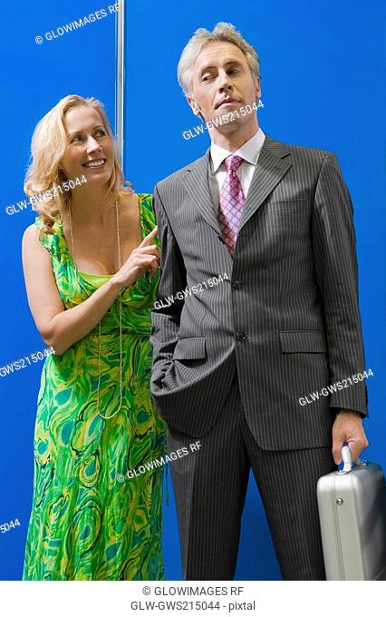 Mature couple standing in an elevator