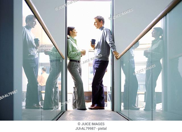 Coworkers talking in doorway