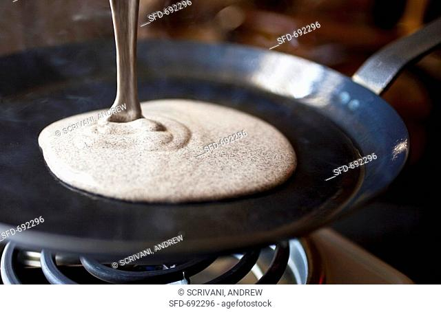 Pouring Buckwheat Crepe Batter onto a Hot Skillet