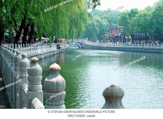 China, Beijing, view of the Silverbar Bridge, Houhai Lake with a view of the Silverbar Bridge
