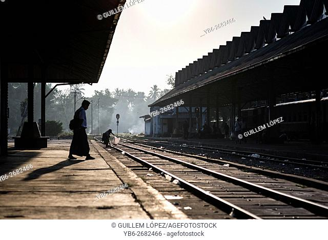 Silhouette of People waiting for the train at the Yangon Central Train Station, Myanmar