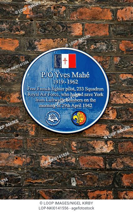 Blue plaque on wall to Free French fighter pilot Yves Mahe