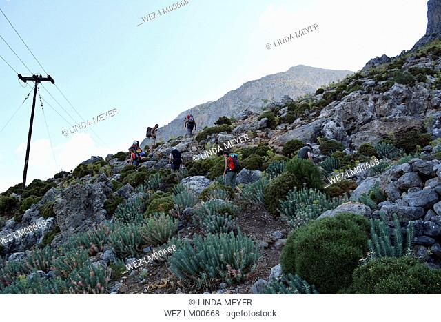 Greece, Kalymnos, climbers walking towards rock