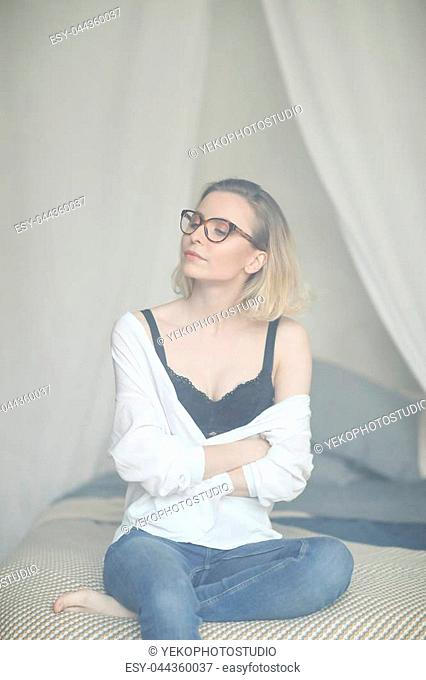 Fashion. Woman with black bra in room full of smoke