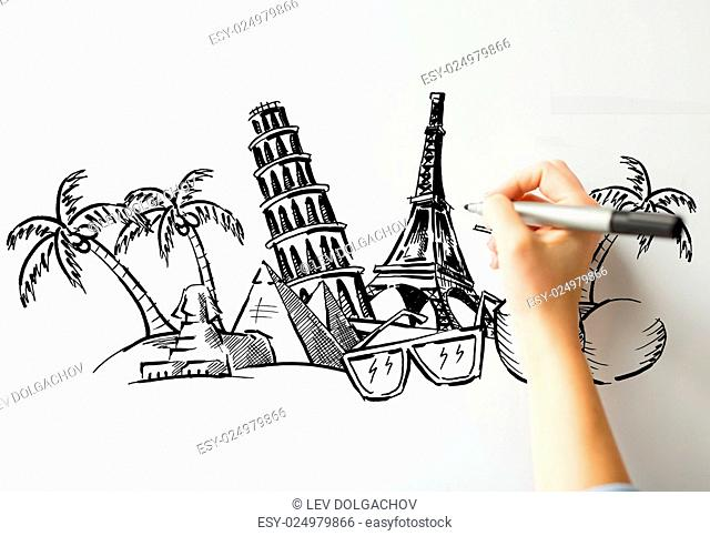 people, travel, tourism, summer vacation and graphic arts concept - close up of hand with marker drawing drawing touristic landmarks sketch on white board or...
