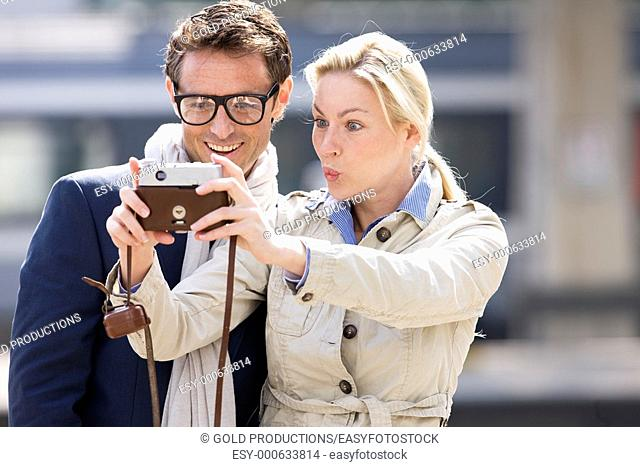Couple with vintage camera