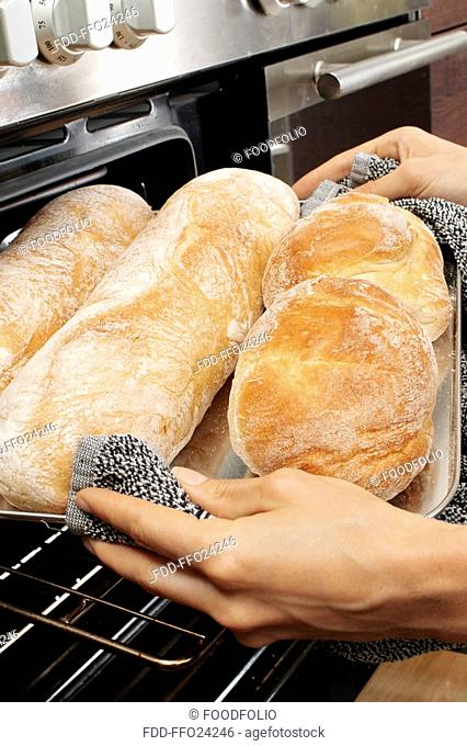 Woman In Kitchen Baking Italian Bread
