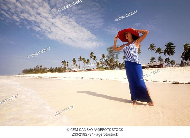 Woman with straw hat on the beach, Nungwi, Zanzibar, Tanzania, East Africa