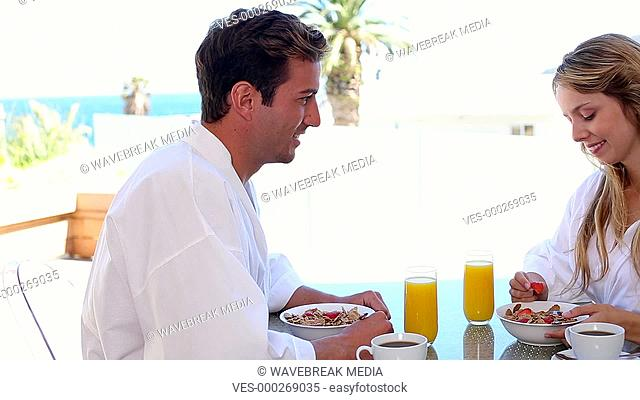 Happy couple having breakfast together