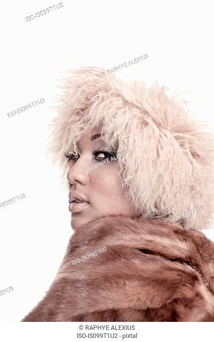 Young woman wearing fur