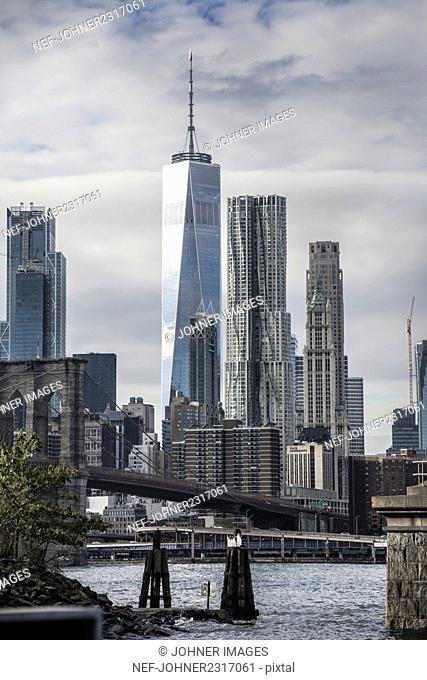 City view with One World Trade Center and East River, New York City, USA