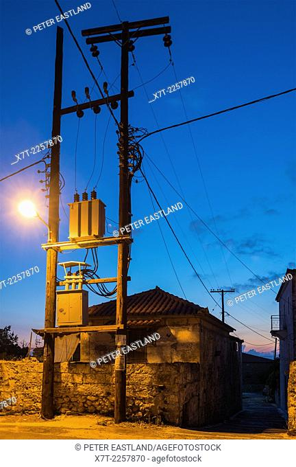Electricity power supply cables and transformers in the little village of Proastio in the Outer Mani, Peloponnese, Greece