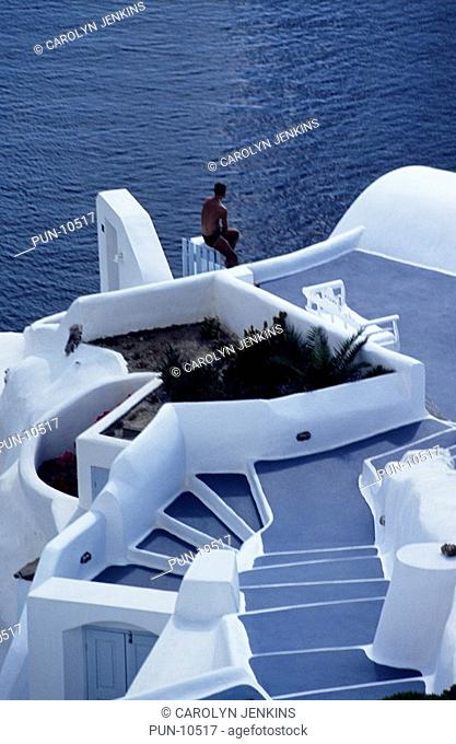 Relaxing on the terrace at Firostefani, Santorini, Cyclades, Greece