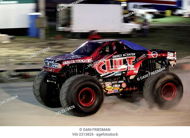Cult Energy speeds along the track during a monster truck rally in Toronto. Monster trucks have become a popular form of entertainment throughout North America