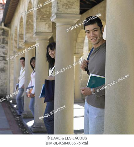 Group of university students leaning on columns, Perth, Australia