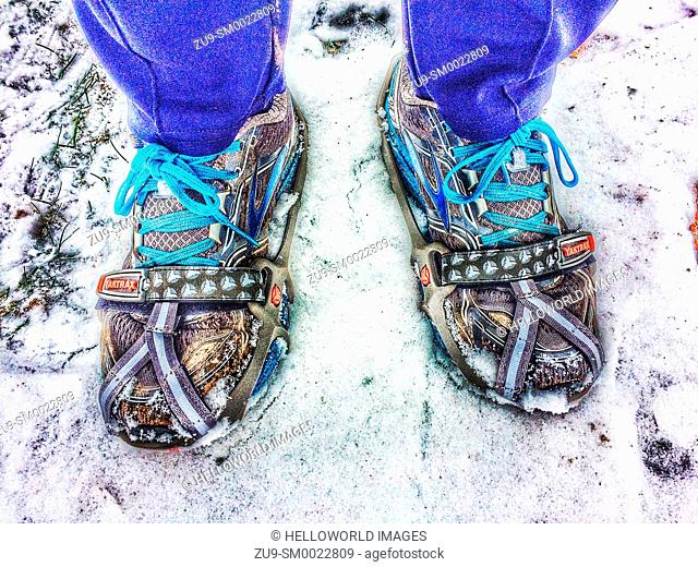 Spikes and coils attached to running shoes to give traction in snow and ice
