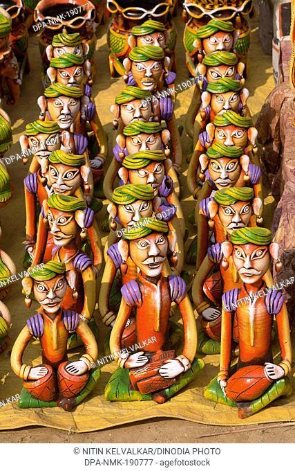 statues of musician kept for sale Surajkund mela Faridabad Haryana India Asia
