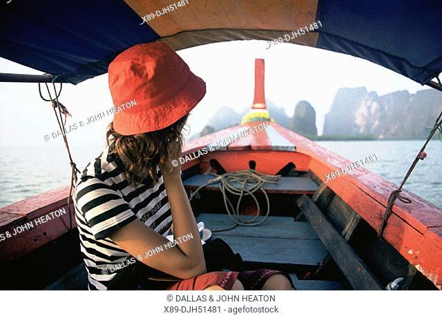 Thailand, Phuket, Phangnga National Park, Woman in Long Boat
