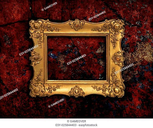 Precious golden vintage frame on red grunge background