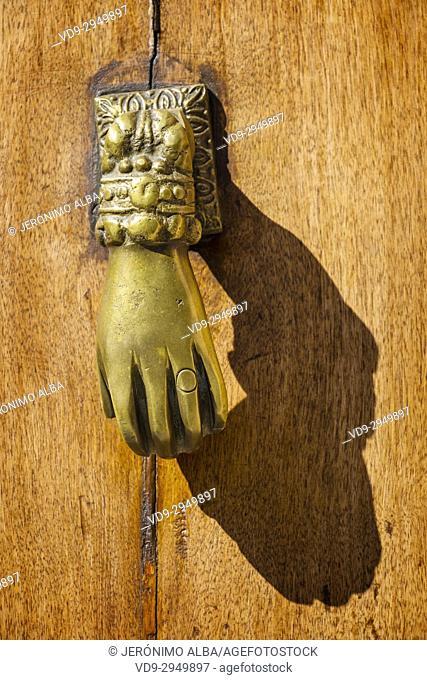 Metal knocker old wooden door, Ronda. Málaga province Costa del Sol, Andalusia. Southern Spain Europe