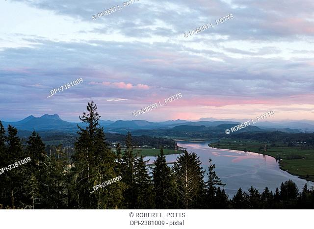 Clouds turn pink in the evening over Youngs Bay; Astoria, Oregon, United States of America