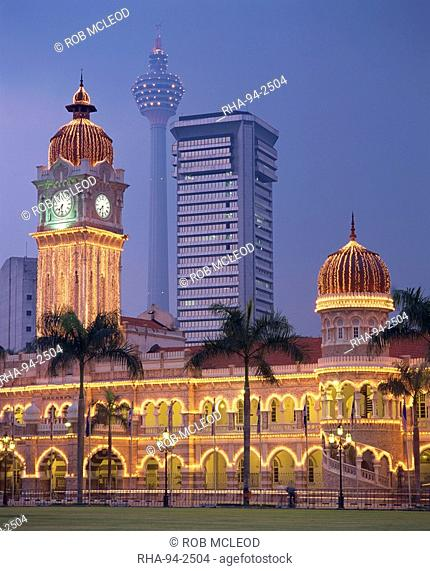 The Sultan Abdul Samad Building, formerly the Secretariat, illuminated at dusk, seen from Merdaka Square, Kuala Lumpur, Malaysia, Southeast Asia, Asia