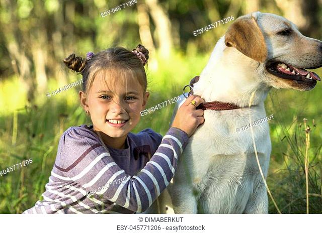 Portrait of a little girl with a dog